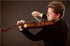 Julian Rachlin played like a wild man, in a good way, in the Shostakovich first violin concerto with the Orchestre National de France on Sunday afternoon.