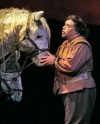 Sancho Panza (Eduardo Chama) does some horse whispering to calm Don Quixote's steed, Rosinante, and his own donkey; edited image, based on a Cory Weaver photograph, courtesy of San Diego Opera.