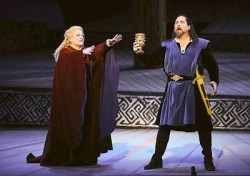 "Tristan holds what he believes to be the cup of friendship offered to him by Isolde. Clifton Forbis plays one of the lead roles as Tristan, and Deborah Voigt performs in the lead role of Isolde. <br /><span class=""credit""><br /></span>"