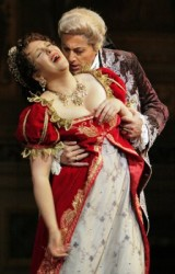 <em>Scarpia (Lado Ataneli) makes a move on Tosca (Adrianne Pieczonka)<br /></em>