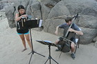 "Clancy Newman and Kristin Lee perform his composition ""Golden Blues"" at a camp site along the Colorado River."