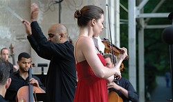 "Tessa Lark performing Corigliano's ""The Red Violin: Suite"" in Central Park with Ensemble LPR led by Ankush Bahl (center left)."