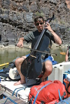 Newman plays The Swan while floating down the Colorado River.