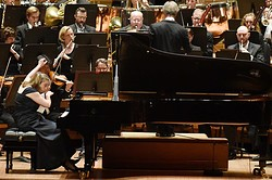 David Robertson, right, conducts the Dallas Symphony Orchestra with pianist Orli Shaham as they perform Bernstein's Symphony No. 2 The Age of Anxiety.